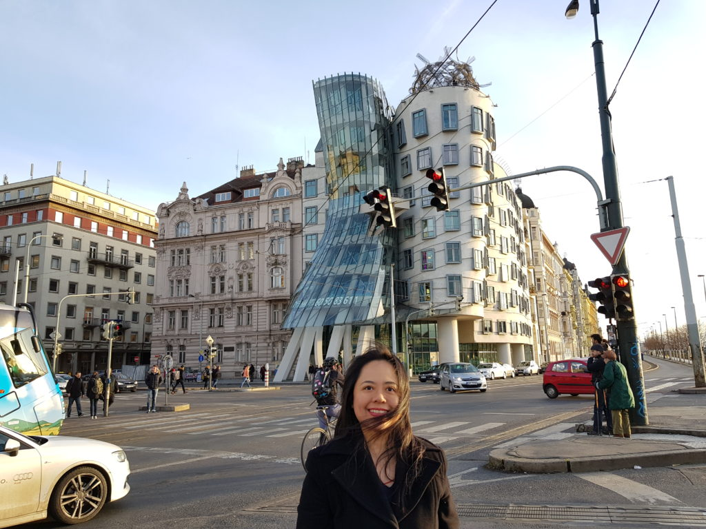 """Master Angela Ang in front of the famous """"dancing building"""" of Prague"""